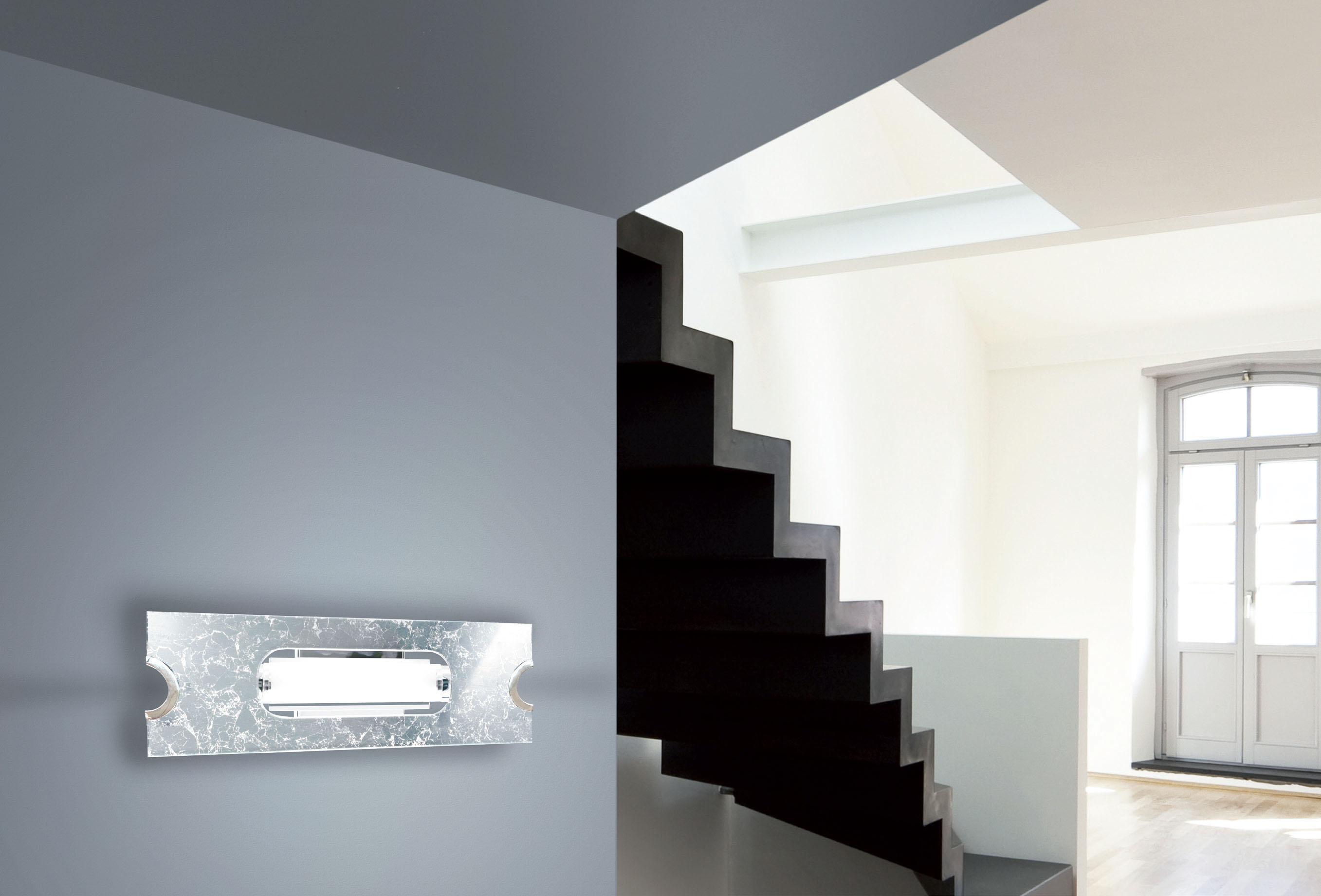 Sikrea lampada da parete swing a argento for Parete argento
